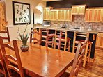 Main level dining area with seating for 8-10 guests plus great kitchen with 4-bar seats - Park City Tranquility - Park...