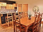Main level dining area with seating for 8-10 guests plus great kitchen with 4-bar seats