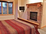 Upper level master bedroom suite with king bed, gas fireplace, 32' TV, and Blue Ray DVD, plus huge private master...