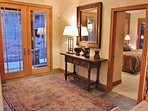 Front door entrance on the lower level of Park City Serenity - Park City with a foyer that leads up to the grand...