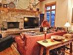 Upper level living room of Park City Serenity - Park City features a gas fireplace, 70' HDTV with a DVD player, and...