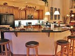 Gourmet Kitchen of Park City Serenity - Park City island including granite countertops and bar stools.