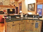 Gourmet Kitchen of Park City Serenity - Park City Island including granite countertops and custom cabinets.