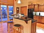 Gourmet Kitchen of Park City Serenity - Park City features granite countertops, new appliances, and custom cabinets.