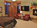 Grand master suite of Park City Serenity  - Park City with a king bed, 60' HDTV, and a gas fireplace. Featuring a...