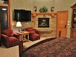 Grand master suite of Park City Serenity - Park City including a king size bed with a 60' HDTV and gas fireplace...