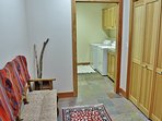 Ski changing room with bench seating, closets, and adjacent laundry room and 2-car garage - Park City Tranquility...