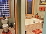 Grand master suite bathroom of Park City Serenity - Park City including a jetted tub and stone shower.