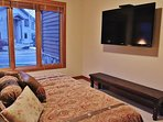 Third master suite of Park City Serenity - Park City located on the lower level. Featuring a king bed, 60' HDTV, and...