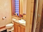 Lower level hallway bathroom of Park City Serenity - Park City located conveniently next to the fifth bedroom.
