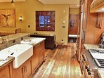 Gourmet display kitchen with Sub Zero refrigerator, Viking gas stove, and top-of-the-line finishes