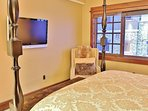 Grand master bedroom with king bed, 40' HD TV, and full bathroom