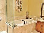 Grand Master bathroom with stone shower, jetted tub, and dual vanities