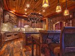 Gourmet display kitchen mountain rustic finishes with 8-burner gas Wolf Stove, built-in Sub Zero refrigerator, and...