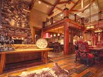 Large family room off kitchen with lots of cozy seating, 2nd dining table, and luxury rustic mountain finishes