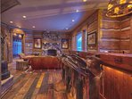 Pony up to the bar with saddle seating and rustic mountain finishes