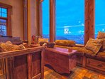 Second family room with stone fireplace, amazing views, and cozy seating
