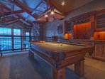 Upper loft with pool table, wet bar, and rustic mountain timber finishes