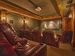 Large movie theater with 12-seats, 120' theater screen, and surround sound