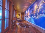 Amazing foyer with custom house artwork and rustic mountain timber finishes