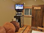 Kids playhouse living room including 32' HD TV w/ HD Direct TV & 180 premium/movie channels, Blue Ray DVD, surround...