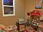 Kids playhouse kitchen that is heated all winter
