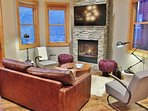 Great living room with 50' HD Smart TV, gas fireplace, and private deck- Park City Resort Estate