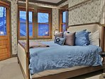 Grand master bedroom suite with King bed, 40' HD Smart TV, private deck, walk-in closet, and large private bathroom...