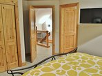 Second master bedroom suite with queen bed, 32' HD Smart TV, and large private bathroom- Park City Resort Estate