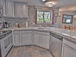 New Kitchen with Granite Counters and Stainless Steel Appliances