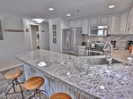 New Kitchen with Granite Counters, Stainless Steel Appliances and Counter Seating for 3
