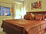 Master bedroom suite with TV and private bath in Snowblaze 310 - Park City