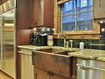 Kitchen of Badgerland - Park City. Amazing gourmet display kitchen with Sub Zero, Wolf stove, granite counters, and bar...