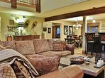 Living Room of Badgerland - Park City. Living room with huge stone fireplace, vaulted ceilings, TV/DVD