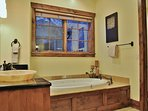 Master Bathroom of Badgerland - Park City. Grand master bathroom with jetted Roman tub, stone shower, and dual vanities