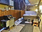 Back Patio with seating area, grill, and hot tub at Badgerland - Park City