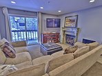 View of kitchen, dining area, & living room with fireplace and 47' HD TV/DVD with Wii & Xbox in Snowblaze 208 - Park ...