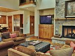 Living Room with lots of seating, fireplace, and TV in Lookout 22 - Deer Valley