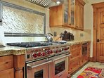 Gourmet Kitchen with granite countertops, stainless steel appliances and huge island in Lookout 22 - Deer Valley