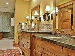 Grand Master Bedroom Bathroom with double vanities, huge tub, and shower in Lookout 22 - Deer Valley