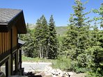 View from side yard of ski slopes and mountains in backdrop at Lookout 22 - Deer Valley