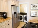 Laundry room with front load washer and dryer is just off kitchen thru a pocket door.