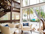 The reading nook and open stairway enjoy 2-storey windows with views to the beach.