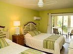 Guestroom with 2 queen beds, ensuite with new tub/shower, private cove view balcony, A/C and HD TV.