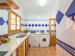 Fully equipped kitchen: Refrigerator, freezer, washing machine, dishwasher, microwave, coffee maker,
