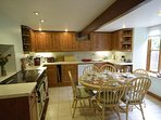 Family kitchen with dishwasher, range cooker, fridge freezer and microwave