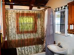 Cigar House bathroom with antique free standing tub & shower