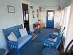 Enjoy your favorite book on this porch offering easy access to come and go to the beach from the side door - 17 Ocean...