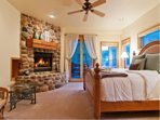 A master suite with a fireplace