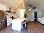 Open concept, brand new renovation, loft is seen in background